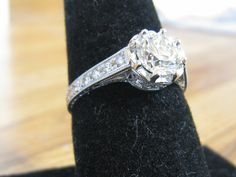 Great compromise has the round stone and bling that Rick loves with the vintage style I adore