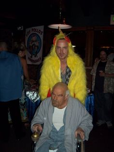 Bryan Cranston dressed up as Hector being pushed by Aaron Paul in a Los Pollos Hermanos chicken outfit.....Is there anything they cant do???