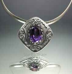 I love metal clay.  This piece has an Alexandrite set in fine silver metal clay with sterling silver gallery wire.  I embedded the wire into the wet metal clay, fired it and set the stone after that.  The stone changes color with different lighting.  - Lisa Barth
