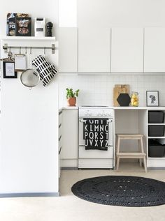 A black and white kitchen area out of the blue!!!!Even though the space is small it makes you feel like you are at home.