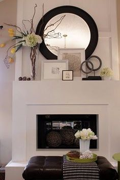 Styled mantle with round mirror and framed artwork. Description from pinterest.com. I searched for this on bing.com/images