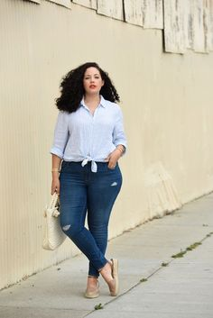 Girl with curves styles it in casual street chic. blue linen tie top, distressed jeans and espadrilles.