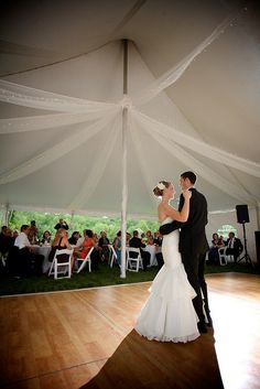 Pole tent wedding with northern birch dance floor. Call us for your quote on this today