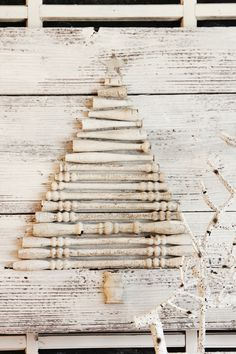 DIY Wood Spindle Tree Winter Decor. Upcycle unused wood spindles into rustic winter home decor using this project tutorial.
