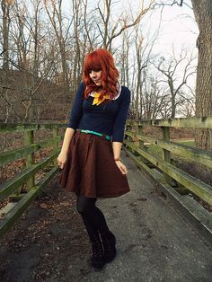 love the colors - navy top, yellow scarf, teal belt, brown skirt