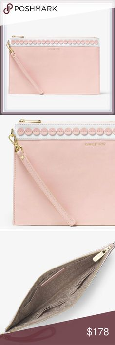 "NWT Michael Kors Analise XL Leather Clutch ➖NWT ❌NO TRADE ➖BRAND: Michael Kors  ➖STYLE: Analise extra large XL Applique Leather Clutch Bag     ➖In blossom white ➖A beautiful leather clutch with dot trim accents that puts a charming touch on this ultra-slim style ➖Has a top-zip closure and a removable wrist strap.         ➖100% Leather         ➖11.5""W X 7""H X 0.5""D         ➖8"" Handle Drop         ➖Interior: 1 Slip Pocket, 6 Card Holders ❌NO TRADE Michael Kors Bags Clutches & Wristlets"