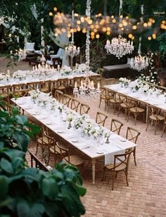 The most gorgeous outdoor tablescape we have ever seen. Rustic, intimate, modern, classic, elegant... There are no words for how beautiful this outdoor Maui, Hawaii wedding is! With glistening low hanging chandeliers twinkling and an all white tablescape and lush greenery, it's the dreamiest setting we've ever seen.