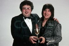 """Photo: Steve Perry and BAM Publisher Dennis Erokan pose for a photo at the 1985 """"Bammies"""", the Bay Area Music Awards, designed to recognize local performers and hosted annually since 1977 by BAM, a San Francisco music magazine. Perry won awards for Outstanding Album and Outstanding Male Vocalist. March 23, 1985 San Francisco, California, USA"""