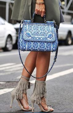 This mismatch combination of tassle heels and mosaic handbag is playful and shows your adventurous side when it comes to fashion!