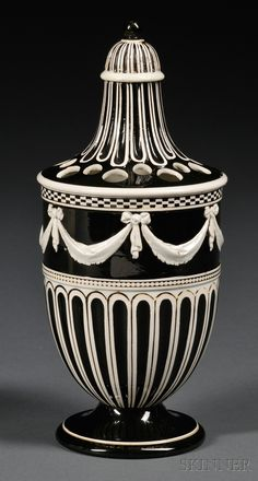 Wedgwood Glazed Pearlware Potpourri and Covers, England, late 18th century, dark brown/black glaze ground with drapery festoons below a checkerboard border, including a dome top with ball finial, pierced cover, and vase.