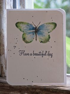handmade card from The Creative Studio ... stamped butterfly done in watercolor technique ... clean and simple design ... like it!