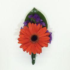 Orange gerbera daisy boutonnière.