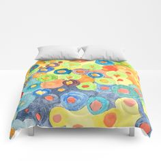 ATTACK OF THE FRUIT LOOPS  Our comforters are cozy, lightweight pieces of sleep heaven. Designs are printed onto 100% microfiber polyester fabric for brilliant images and a soft, premium touch. Lined with fluffy polyfill and available in king, queen and full sizes. Machine washable with cold water gentle cycle and mild detergent.