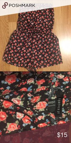 Flower Patterned Romper Black patterned romper. Super cute and comfortable. Pretty short. Midline drawstring. Size: small Forever 21 Pants Jumpsuits & Rompers