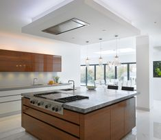 Contemporary, high-gloss, white cabinetry with high-gloss veneer island looks perfect in this bespoke kitchen extension Minimal Kitchen Design, Interior Design Kitchen, Blue White Kitchens, High Gloss Kitchen, Walnut Kitchen, Wardrobe Furniture, Kitchen Dinning, Functional Kitchen, Bespoke Kitchens