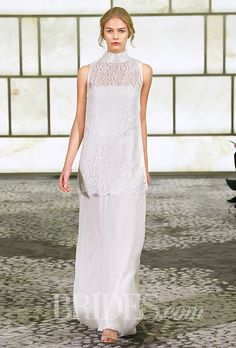 "Brides.com: . Trend: Turtlenecks. ""Sheena"" sleeveless metallic lace tunic top with a turtleneck, shown over a chiffon sheath wedding dress, Rivini"