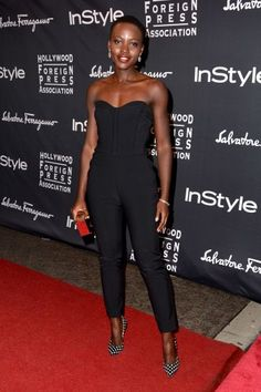 Lupita Nyong'o in Veronica Beard jumpsuit, Calvin Klein clutch, Paul Andrew shoes - At the Hollywood Foreign Press Association and InStyle annual celebration during the Toronto International Film Festival. Hollywood Fashion, Mode Hollywood, Fashion Idol, Star Fashion, Look Fashion, New Fashion, Fashion Black, Fashion Stylist, My Black Is Beautiful