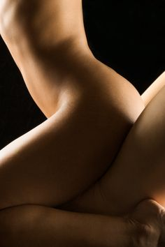 Nude woman straddle man