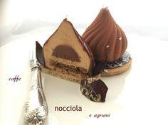 Caffé, Nocciola e Agrumi: pasta frolla viennese, biscotto nocciole e caffè, cremoso di cioccolato e agrumi, mousse pralinata, glassa morbida al cioccolato
