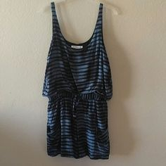 "BCBG Romper BCBGeneration sleeveless romper? Elastic stretchy waistband with tie? Two front open pockets? Lined? Blue and black abstract design? 100% rayon? Size large? Worn once or twice EUC? Measurements laying flat:? Underarm to underarm: 19.5""? Waist NOT stretched: 15""? Waist stretched: 18""? Total length:34.5""? Inseam: 3.5"" BCBGeneration Shorts"