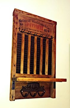 Vintage washboard with shelf and hooks. Awesome repurposed antiques made by Reclaim Your Space.  If you want one check the Etsy store or just shoot me a message!