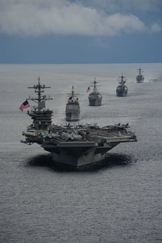 ATLANTIC OCEAN,Sept.23,2014.Aircraft carrier USS Theodore Roosevelt (CVN 71) leads formation of ships of Carrier Strike Group (CSG) 12 during maneuvering exercise.Theodore Roosevelt participated in exercise with Peruvian submarine BAP Islay (SS 35),guided-missile destroyers USS Winston Churchill (DDG 81),USS Forrest Sherman (DDG 98),USS Farragut (DDG 99) & guided-missile cruiser USS Normandy (CG 60).Theodore Roosevelt underway preparing for future deployments.(Mass Comm Spec Katie Lash)
