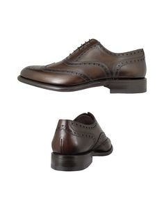 $486 Tanned to a warm brown color and decorated with a brogued wingtip design, the Cayenne oxford offers impeccable attention to detail in handmade Italian style. Signature box included. Made in Italy.