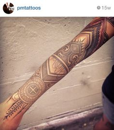 Linear and geometric tattoo.