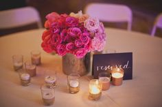 gorgeous centerpiece with an ombre color palette of pink  Photography by taylorlordphotography.com, Wedding Planning by afteryesweddings.com, Floral Design by bowsandarrowsdeluxe.com