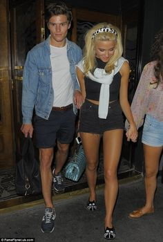 Matching: Pixie Lott and Oliver Cheshire both show off their tans in shorts for an evening out in London