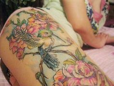 tattoos of hummingbirds and flowers | Beautiful colors on this hummingbird and flower tattoo. | Tattoos