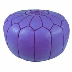 "Showcasing a Moroccan-inspired arch motif and lilac hue, this handmade leather pouf is perfect as an extra seat or an exotic footrest.     Product: PoufConstruction Material: Genuine leather and shredded foam fillColor: LilacFeatures:    Handmade in MoroccoMoroccan-inspired arch motifCan be used as an ottoman or extra seating Dimensions: 12"" H x 21"" Diameter"