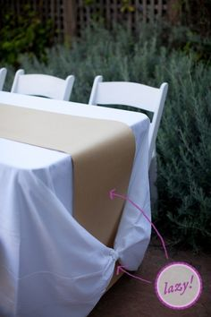 The kraft paper table runner. I mean, it looks so good in restaurants, why not do it for your wedding? Plus, you can throw some jars of crayons out there, and the kids everyone can have a ball. Check out knot in tablecloth at bottom.