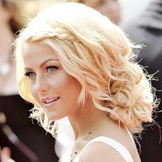 Very cute curly hair with a messy bun and braid, summer look wouldn't mind it for a wedding neither.