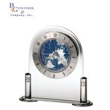 Discoverer :: The revolving world map is accented with deep blue oceans and silver-tone continents and protected by a convex acrylic crystal. Polished silver-tone metal columns and base support the beveled arch. A felt bottom protects fine desks. Quartz, battery operated, alarm movement includes one AA sized battery. #clock #timepiece #gift #personalized #recognition #business #retirement