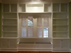 Custom vintage style office built ins with tilt-up window seat and shutters for Vivian Kha in Eastwood.  Inset Shaker style doors.  Paint grade.