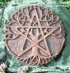 "The Pentacle was known as the Seal of Solomon. It is a symbol of Earth and Prosperity as seen in the tarot. The pentacle in its upright position represents the Spirit in balance and harmony with the four elements. The tree represents the cosmic world tree known throughout many cultures & spiritual paths. Around the edge it reads, ""Seed, root, stem, bud, flower, leaf, fruit,"" representing the endless cycle of rebirth"