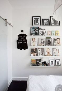21 chic ways to decorate your apartment with books - display fashion books and magazines on shelves