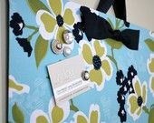 Take a flat cookie sheet and cover w/ fabric for an instant magnetic board...