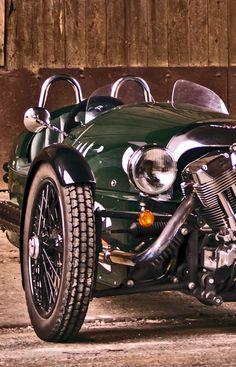 Morgan 3-wheeler | More here: http://mylusciouslife.com/stylish-home-luxury-garage-design/
