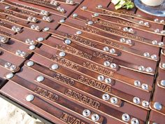 GREAT idea for name tags!! Leather bracelets stamped with the name of the guest.