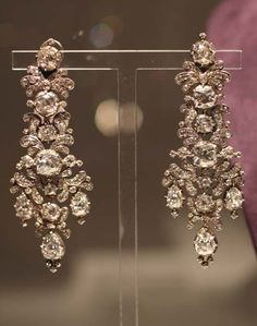 Not that I can afford anything of elizabeth taylor's...but I bet I could find a look-alike!   A pair of antique diamond earrings from ELIZABETH TAYLOR'S JEWELRY COLLECTION