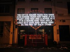 Neon by artist Robert Montgomery at KK Outlet in Hoxton Square, London
