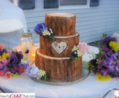 Rustic Tree Stump Wedding Cake Tutorial. Learn how to make the realistic fondant tree bark and carved initials in this easy to follow photo tutorial!