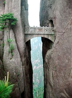 The Bridge of Immortals, the world's highest bridge. Strangely-shaped granite peaks in the Yellow Mountains of eastern Asia, also known as Huangshan, is really something every person should experience. From the bridge you will have a breathtaking view, and see how the clouds are touching mountainsides beneath you.