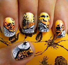 Crazy over the top Halloween candy corn nails