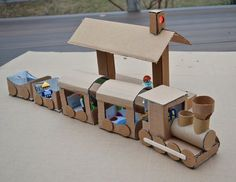 20 coolest toys you can make from cardboard. Great ideas for kids' crafts and indoor activities, plus fun options for DIY Christmas gifts. Kids Crafts, Projects For Kids, Diy For Kids, Cardboard Train, Cardboard Crafts, Paper Crafts, Paper Train, Train Crafts, Recycled Toys