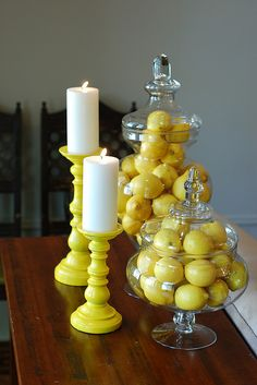 I need to get these big vases and always have lemons in the house. Gotta find the many uses of lemons so they don't go bad. Cheap way to decorate with yellow! Spray paint old candlesticks and fill decorative vases and jars with lemons. Bougie Partylite, Lemon Kitchen Decor, Yellow Kitchen Decor, Kitchen Ideas, Yellow Kitchen Accents, Yellow Kitchen Accessories, Yellow Kitchens, Kitchen Decor Themes, Cheap Kitchen