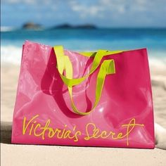 NWOT Victoria's Secret Beach Bag Bright peach-pink colored Victoria's Secret beach bag. Material on exterior keeps bag dry and your items inside dry as well. Great for the beach or a pool day. No marks on interior or exterior. No damage to bag. Victoria's Secret Bags Totes