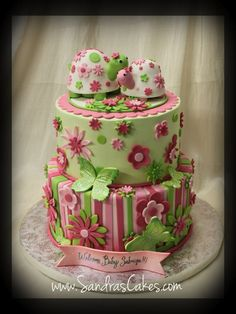 Pink and green floral cake with cute turtles... Eeek sooo cute for a lil girl baby shower!! :)